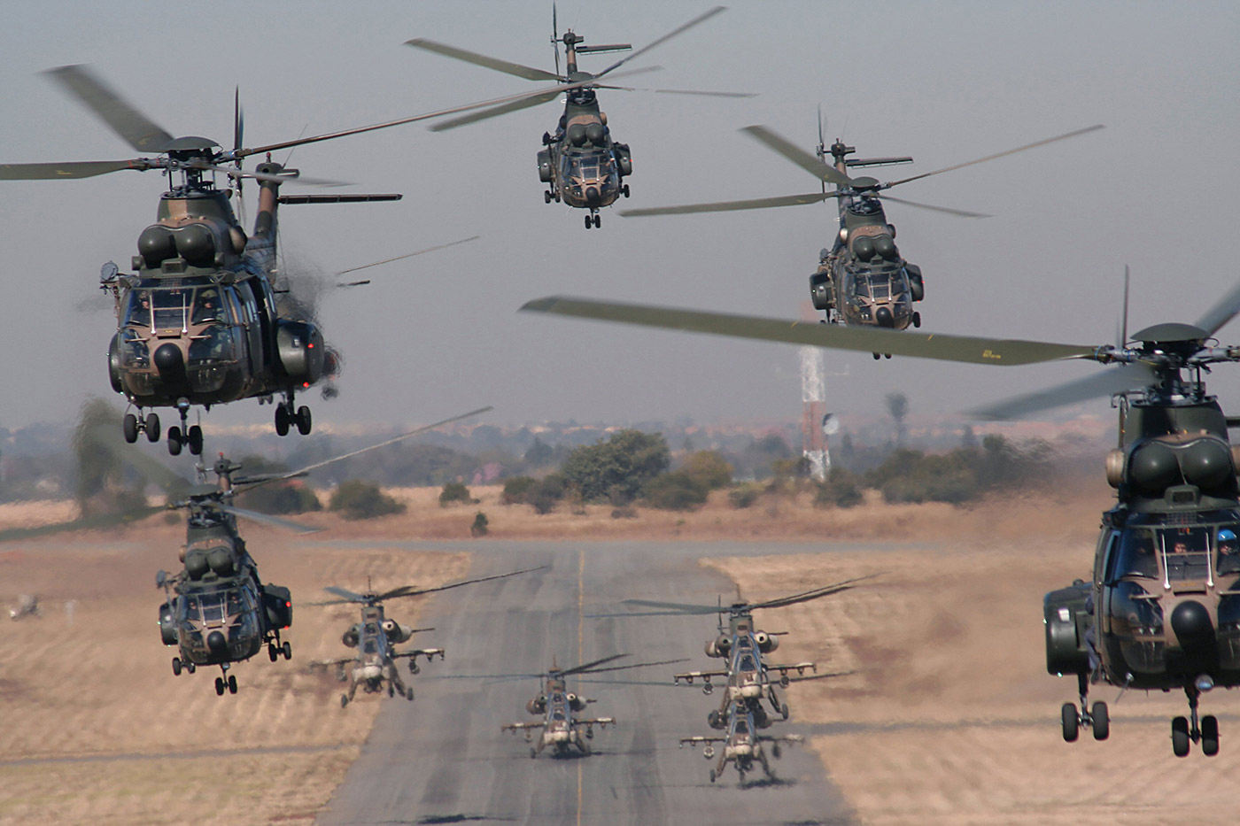 Acme OEM Aerospace & Defense | Aerial view of nine helicopters takilng off